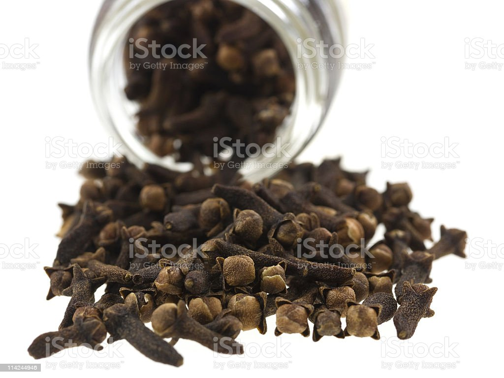 whole cloves coming out of the jar royalty-free stock photo