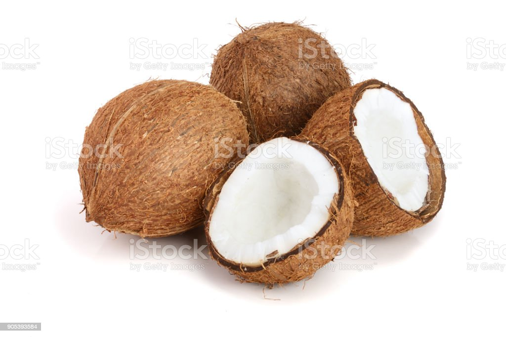 whole coconut and half isolated on white background stock photo