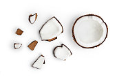Whole coconut and pieces of coconut on white background