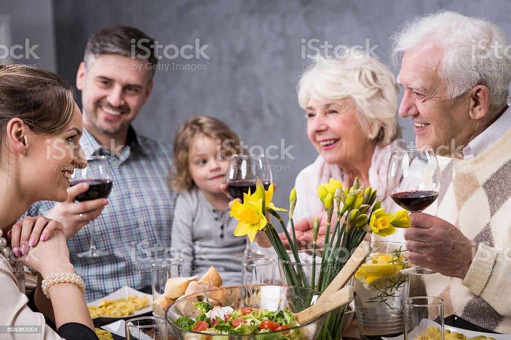 Whole family celebrates meal stock photo