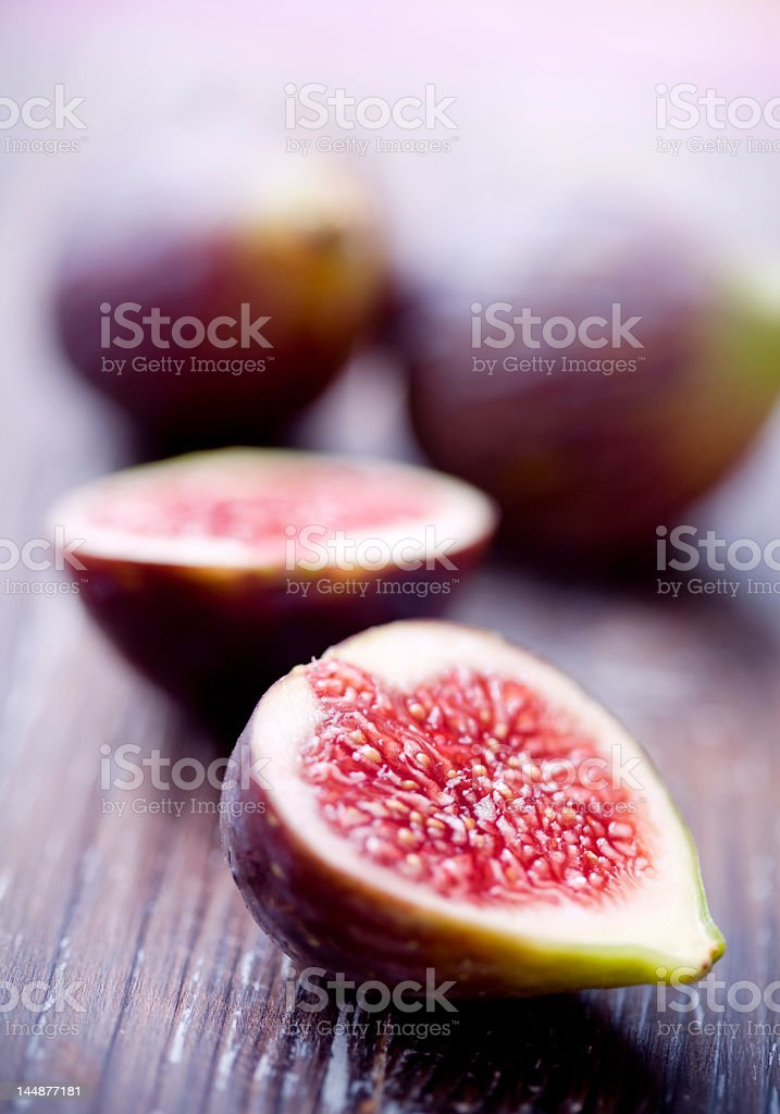 Whole figs and halved figs on a table stock photo