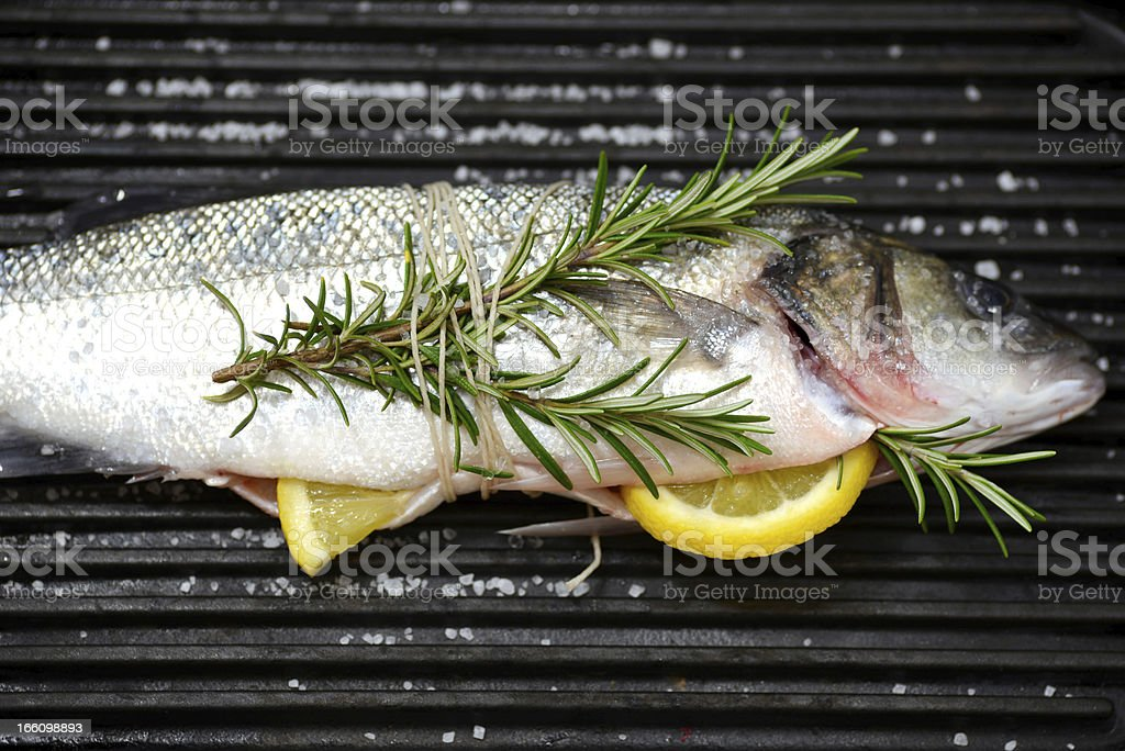 Whole fish on a grill royalty-free stock photo