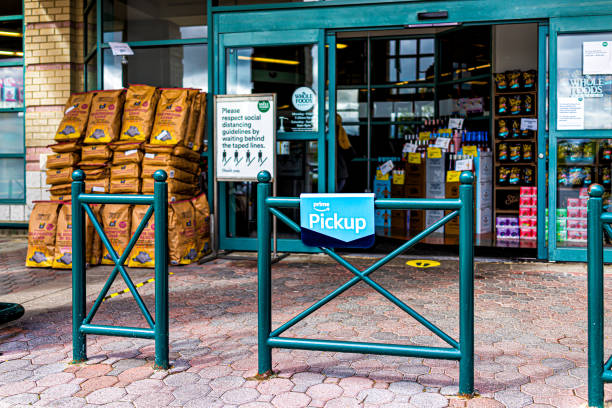 Whole Foods grocery store sign for social distancing with prime food online delivery curbside pickup at coronavirus covid-19 pandemic stock photo