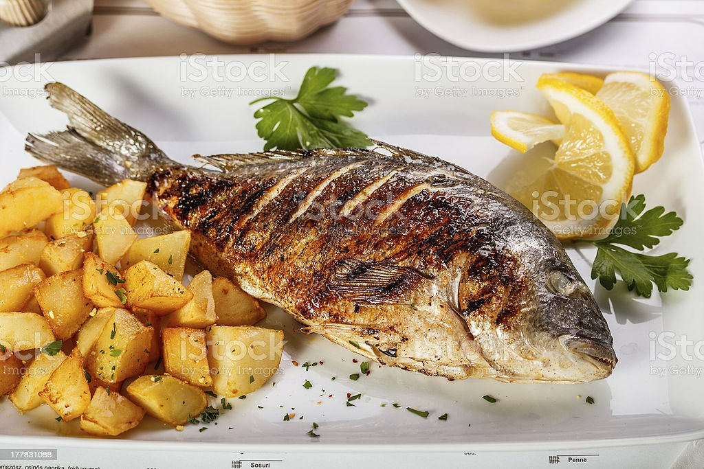 Whole fried dorado stock photo