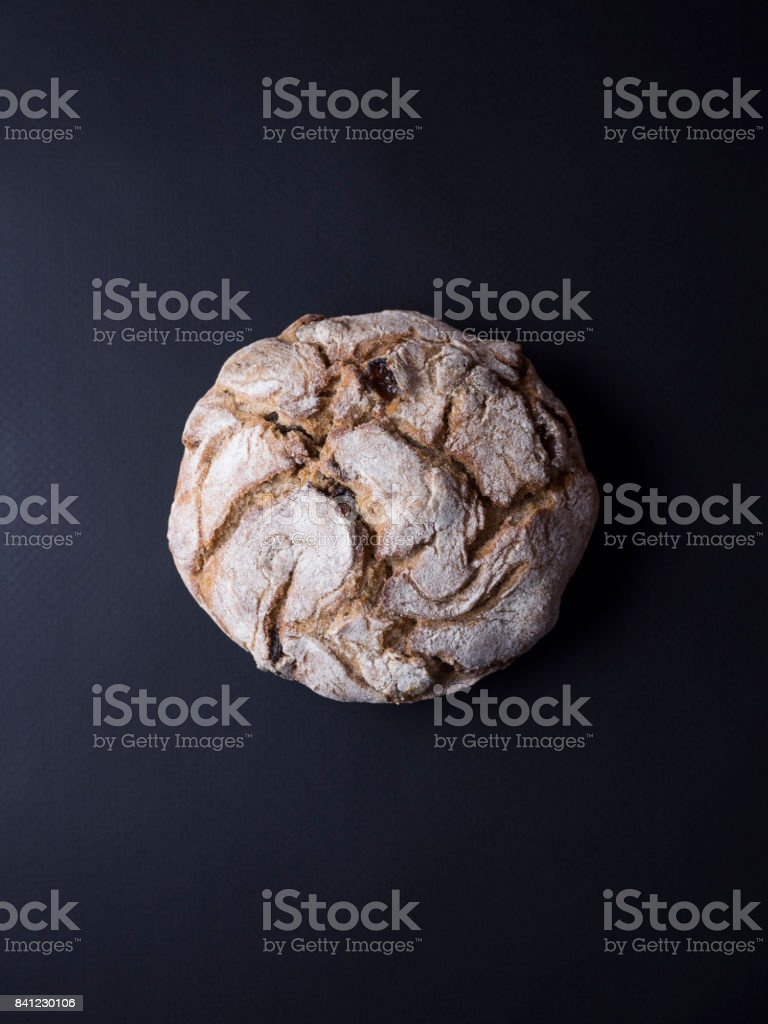 Whole grain bread isolated on black background stock photo