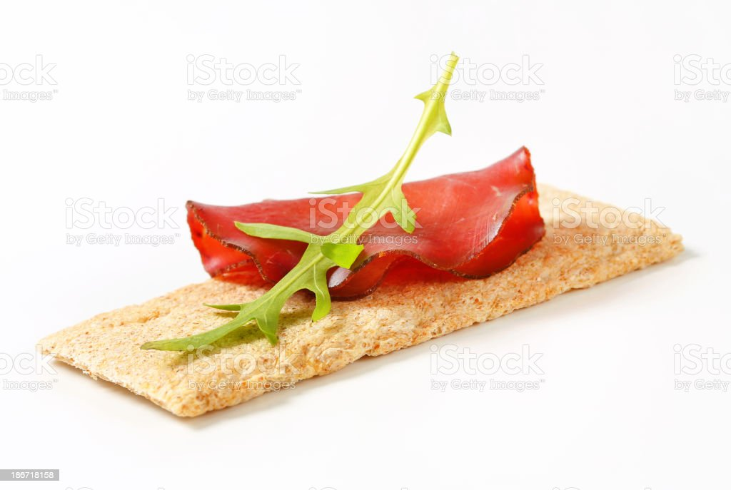 Whole grain crisp bread with smoked beef royalty-free stock photo