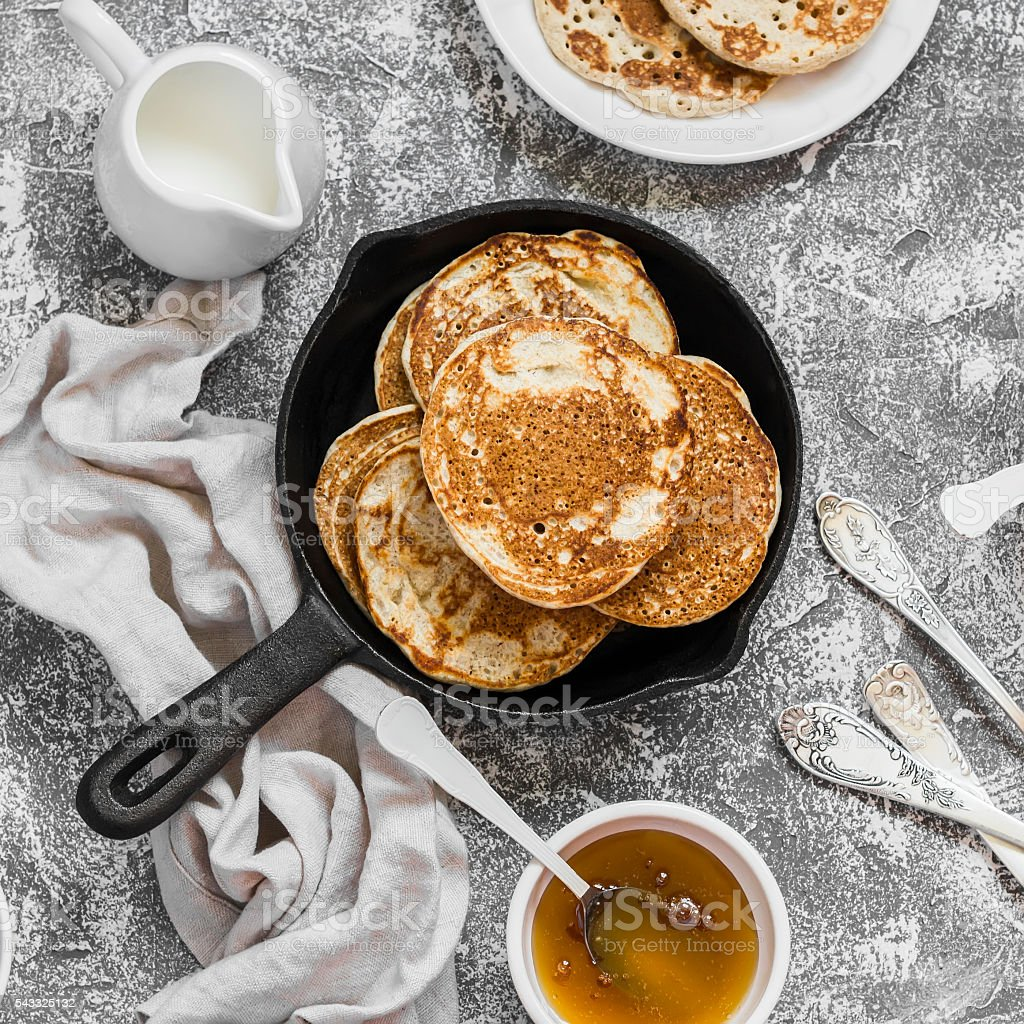 Whole grain pancakes in a cast iron pan stock photo