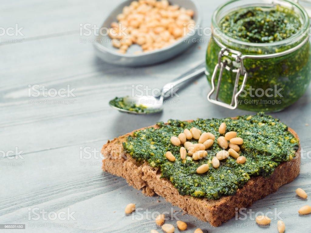 whole grain rye bread with fresh pesto royalty-free stock photo