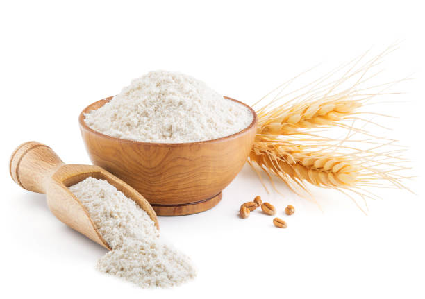 Whole grain wheat flour and ears isolated on white stock photo