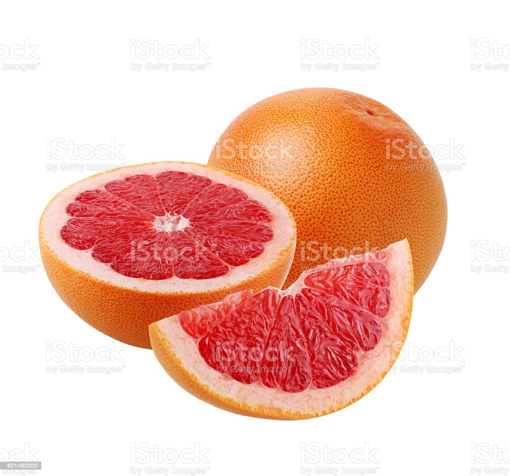Whole grapefruit and cut into pieces, isolate. photo libre de droits