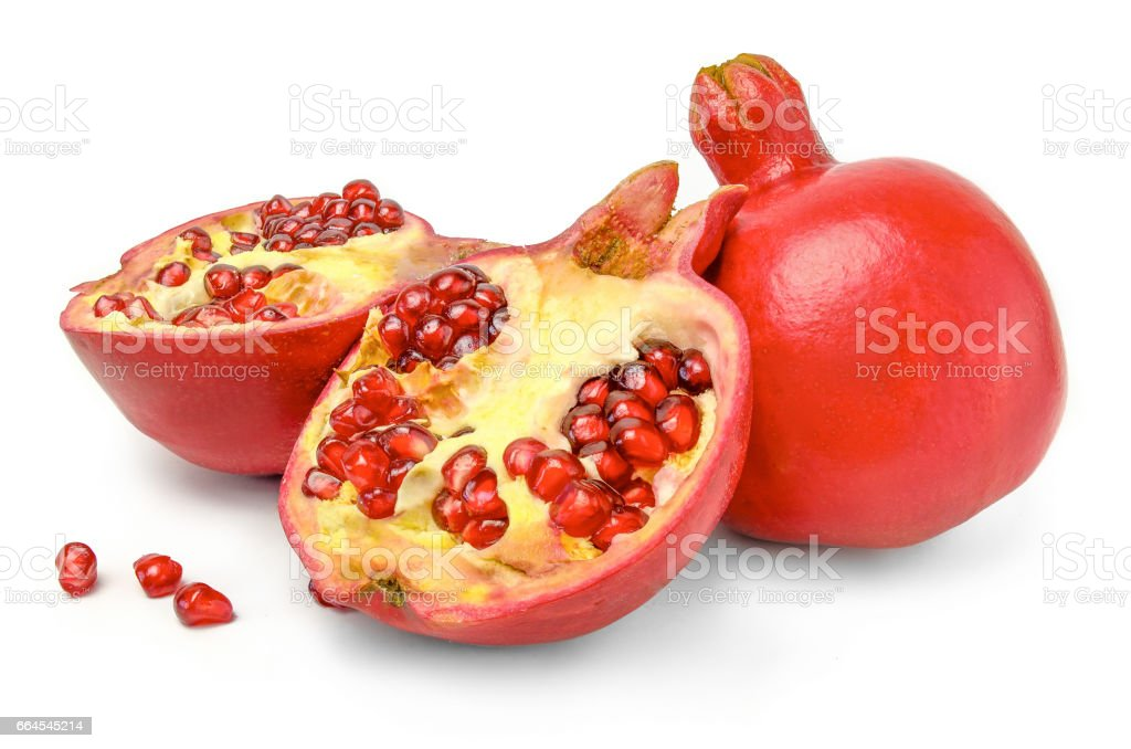 Whole, half and seeds of pomegranate isolated on white background cutout for package design royalty-free stock photo