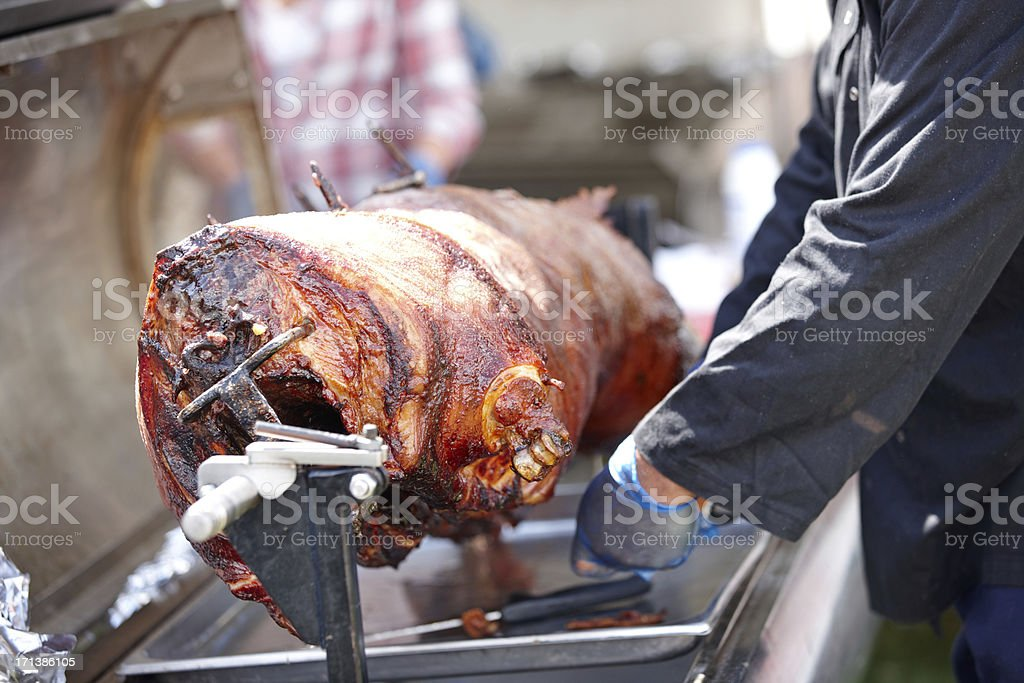 Whole hog roast on the spit stock photo