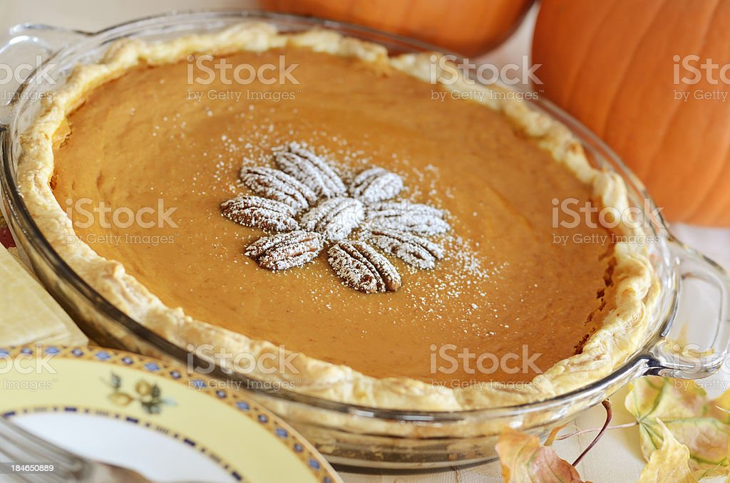 Whole home baked pumpkin pecan pie stock photo