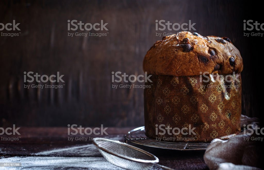 Whole homemade Italian panettone cake stock photo
