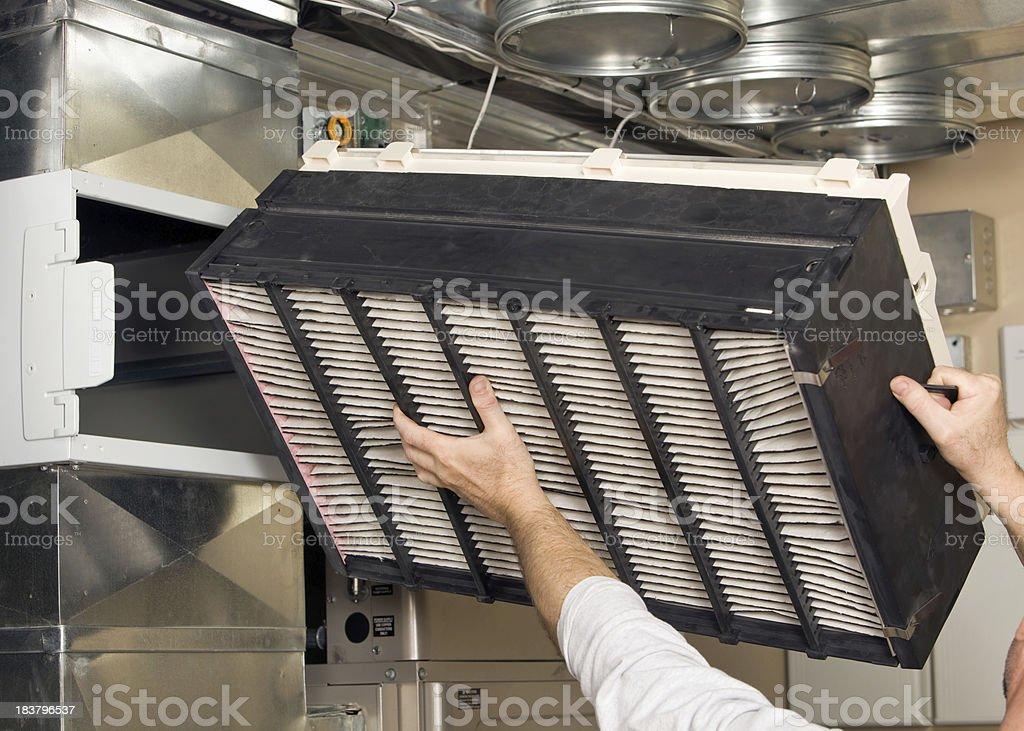 Whole House Air Cleaner Filter Installation stock photo