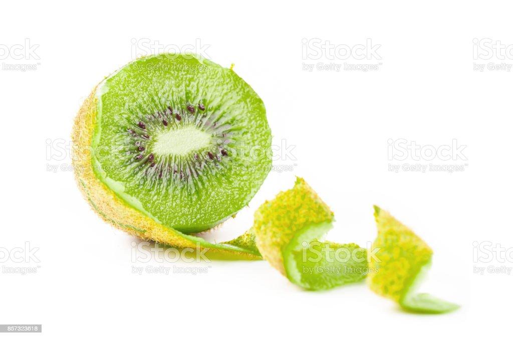 Whole kiwi fruit and his segments stock photo