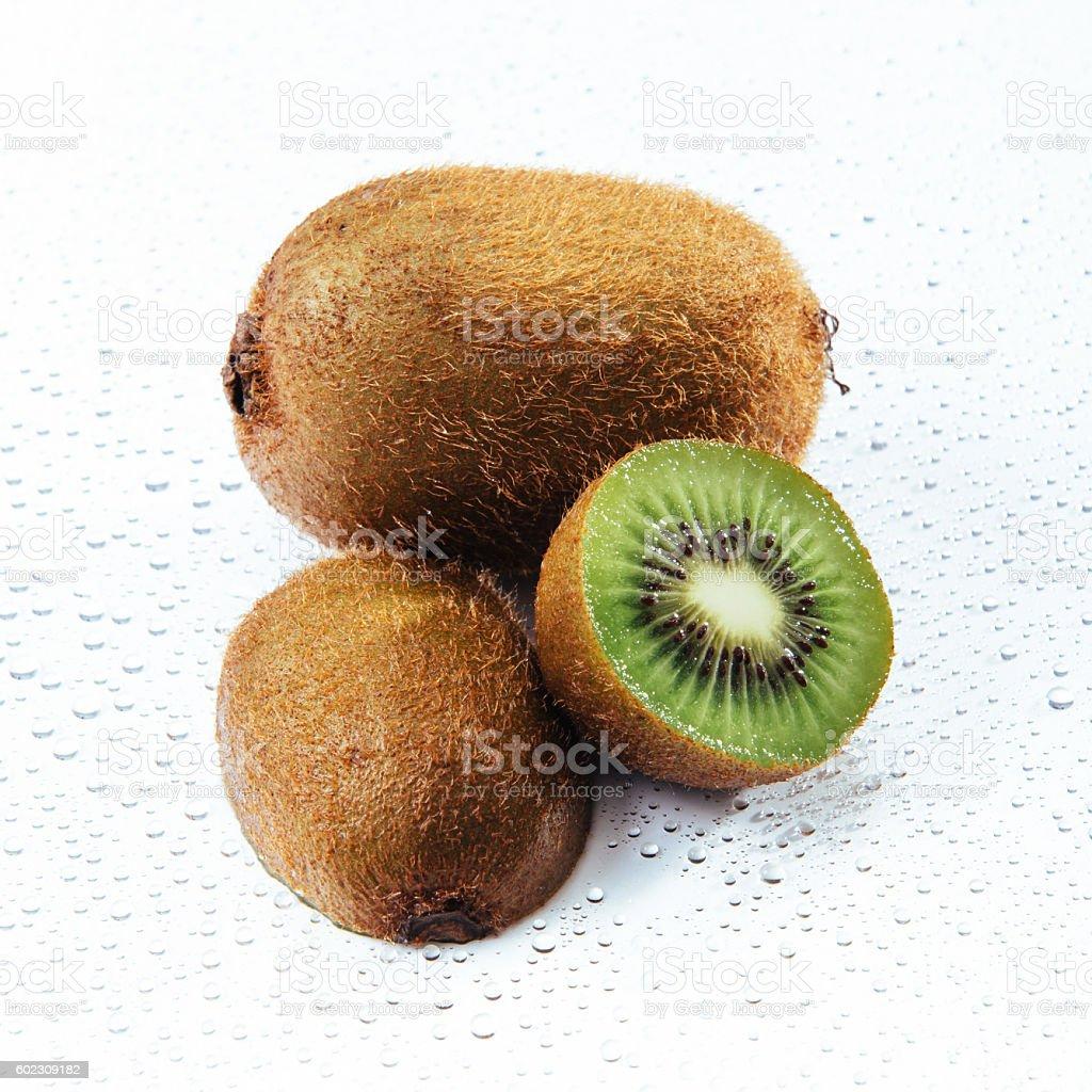 Whole kiwi fruit and his sliced segments isolated stock photo