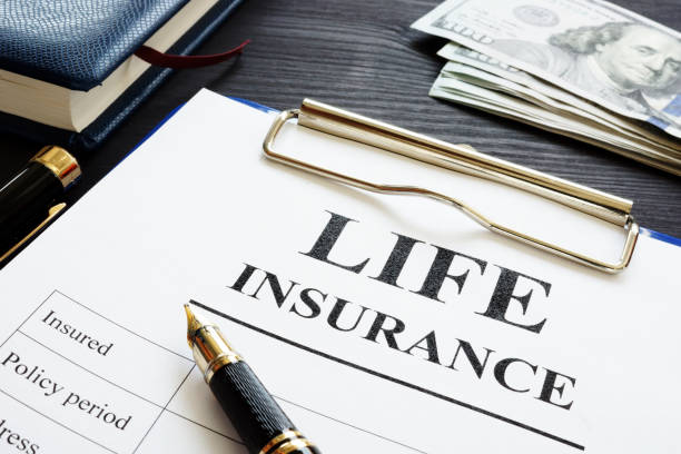 Whole life insurance pen and dollar banknotes. stock photo
