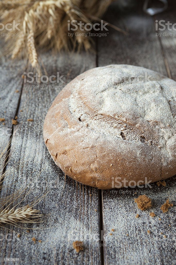 whole loaf of bread on the table royalty-free stock photo