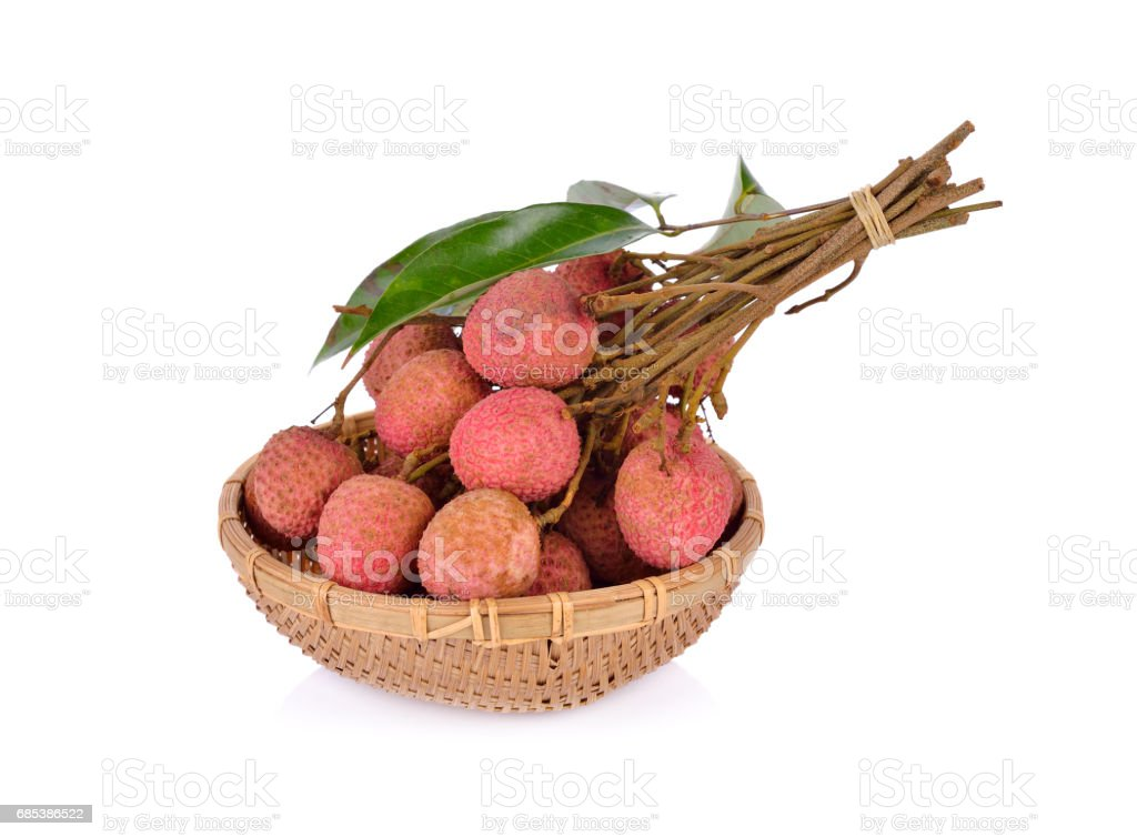whole lychee fruit with stem and leaves in basket on white background foto de stock royalty-free