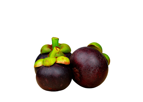 Whole Mangosteen Showing Purple Skin Isolated On White Background With Space Tropical Fruit From Thailand The Queen Of Fruits Asia Fresh Fruit Market Concept Natural Source Of Tannin And Xanthones Stock Photo - Download Image Now