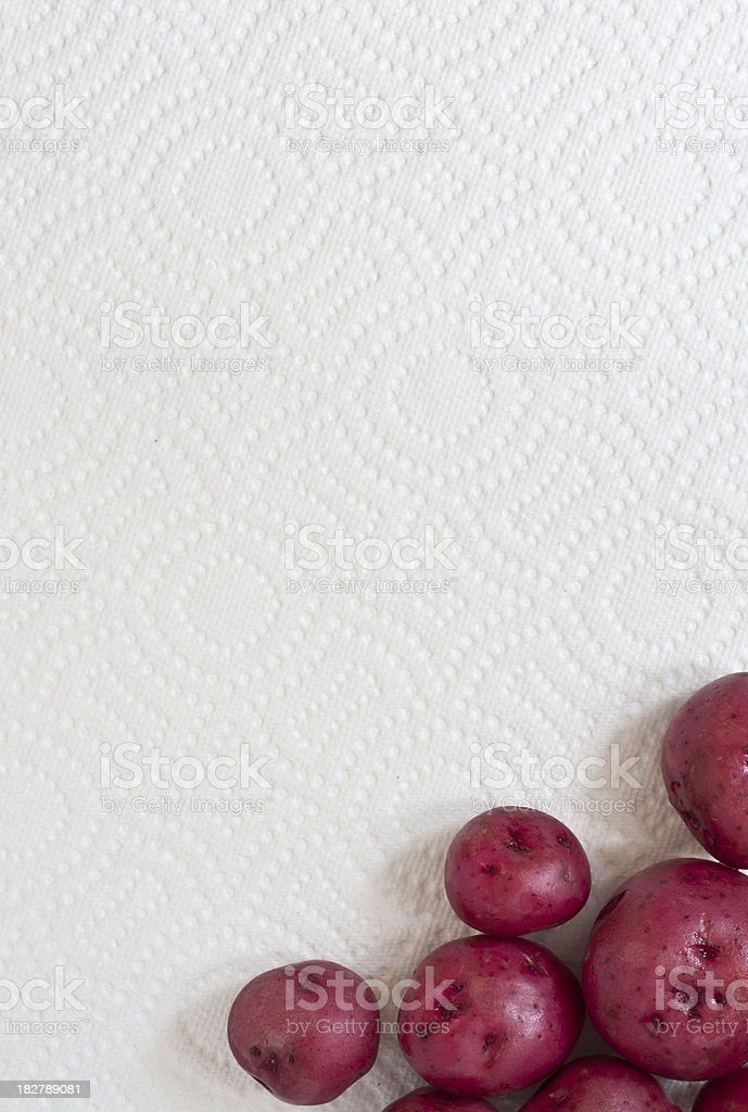 Whole New Red Potatoes on a Paper Towel Background stock photo