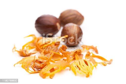 sweet food / bakery for christmas: Whole nutmeg and mace isolated on white background