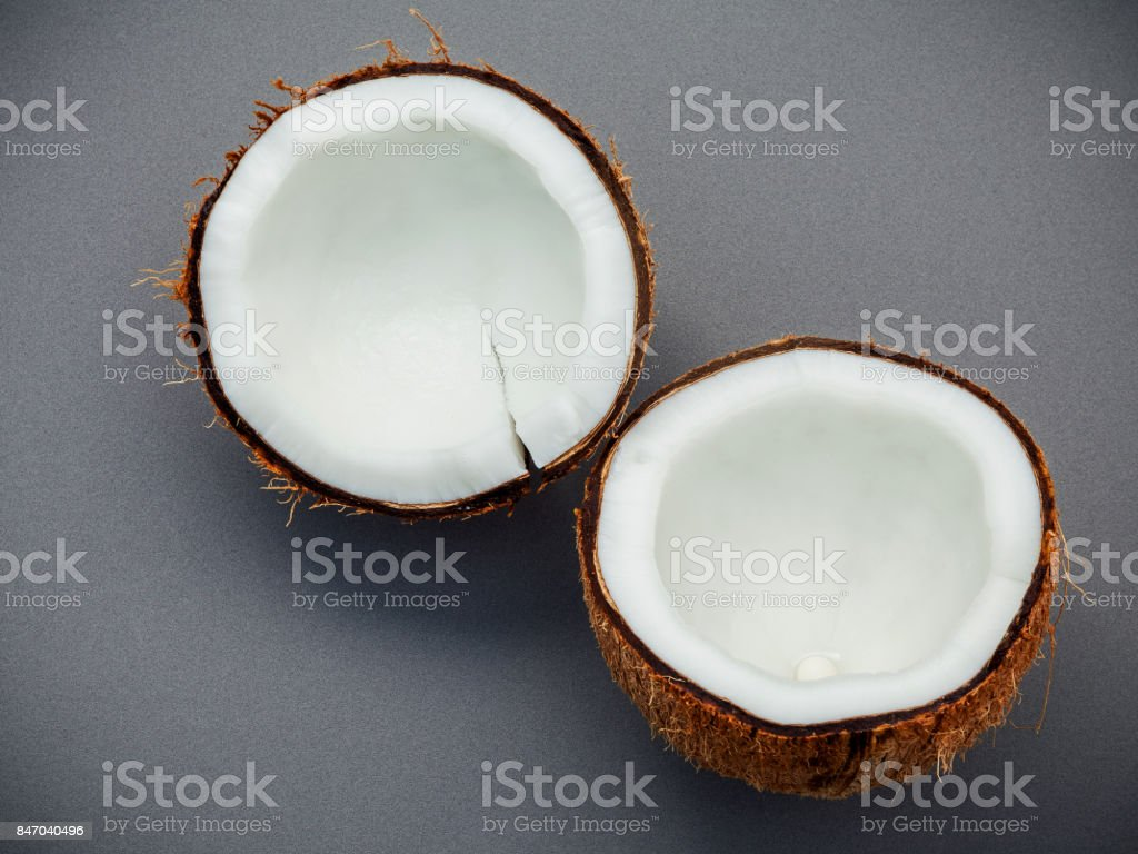 Whole of coconut shell on gray background flat lay and copy space. top view stock photo