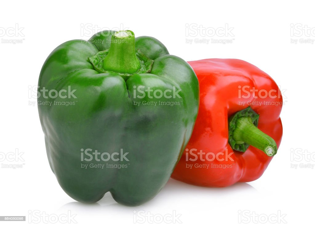 whole of green and red sweet bell pepper or capsicum isolated on white background stock photo