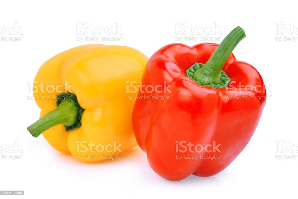 whole of yellow adn red sweet bell pepper or capsicum isolated on white background stock photo