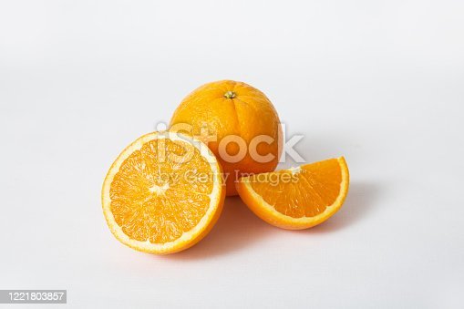 Whole orange fruit and cut segment and half isolated on white background. Closeup shot. Natural vitamin or organic food concept