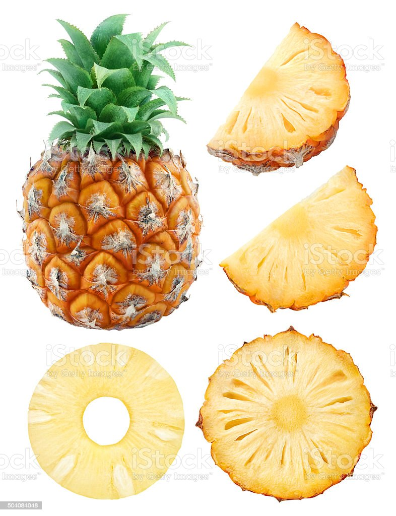 Whole pineapple and pieces isolated on white with clipping path stock photo