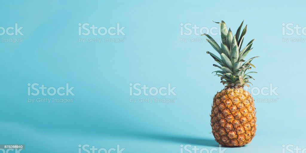 Whole pineapple on a bright background stock photo