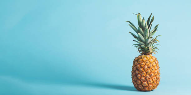 whole pineapple on a bright background - ananas zdjęcia i obrazy z banku zdjęć