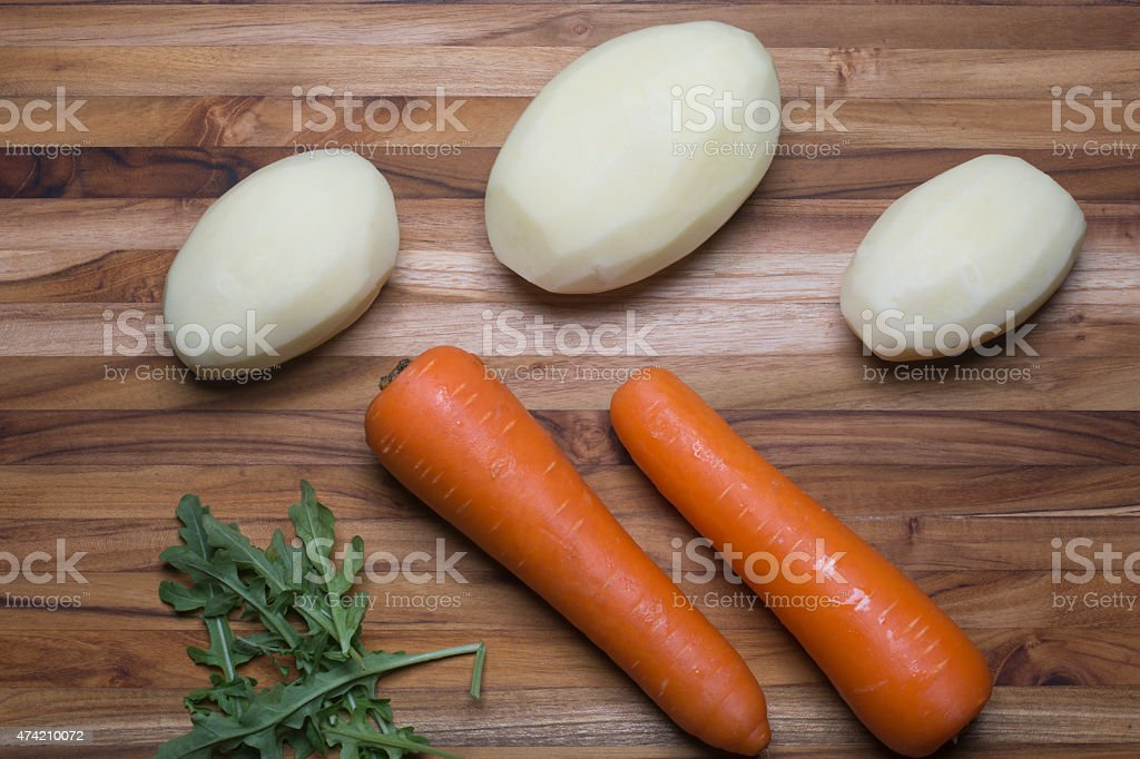Whole Potatoes and Carrots stock photo