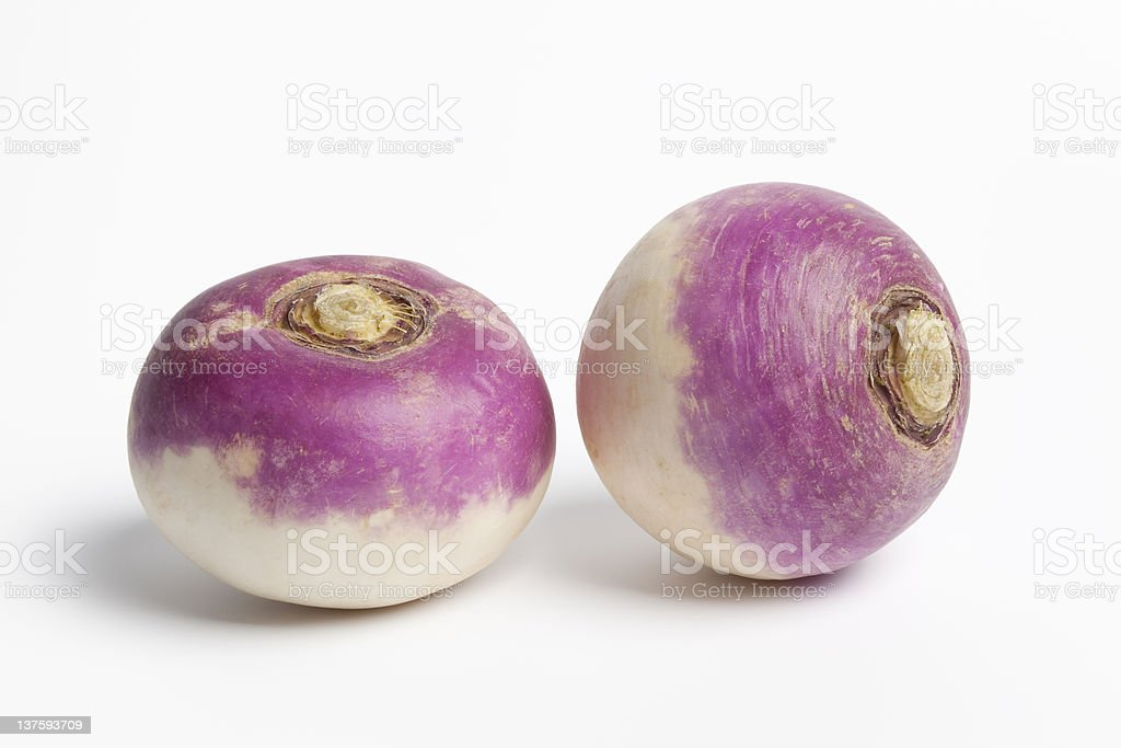 Whole purple headed turnips on white background stock photo