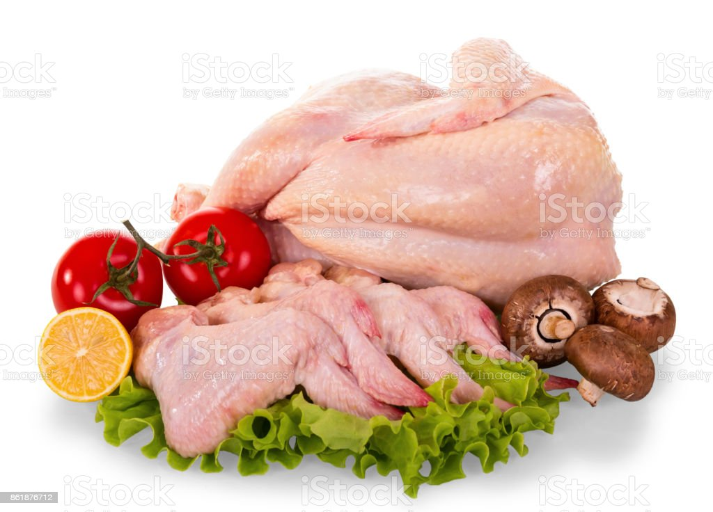 A whole raw chicken carcass and wings, tomatoes, mushrooms, lemon and lettuce leaves isolated on white. stock photo