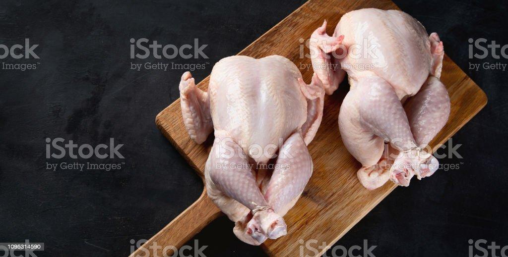 Whole raw chicken stock photo