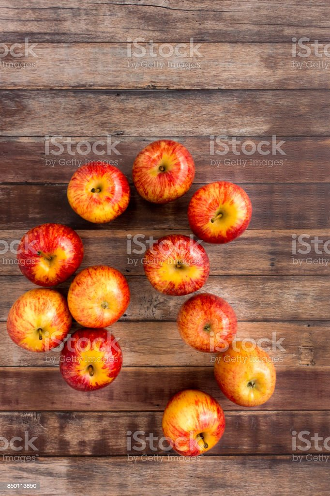 Whole Red Apples on Brown Wood Background stock photo