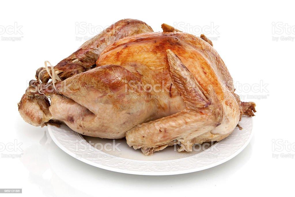 Whole roast turkey on white background royalty-free stock photo