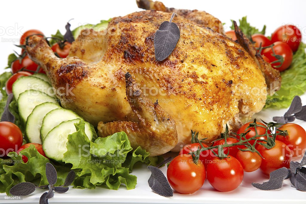 Whole roasted chicken on white royalty-free stock photo