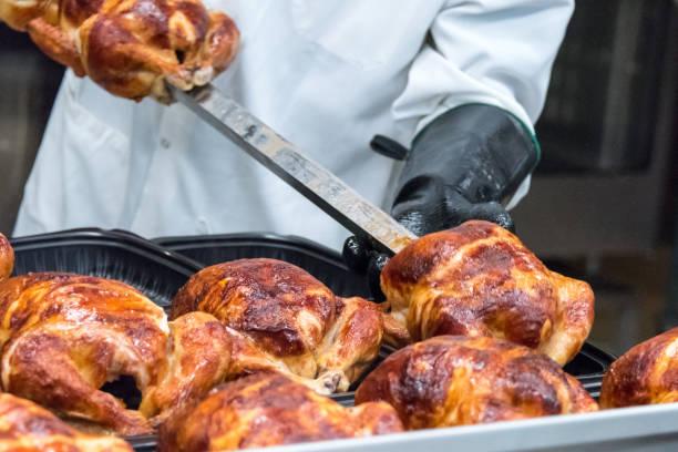 whole roasted chickens for sale - girarrosto foto e immagini stock
