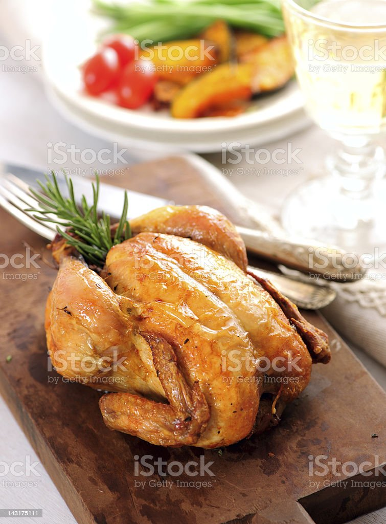 Whole Roasted Game Hen Dinner stock photo