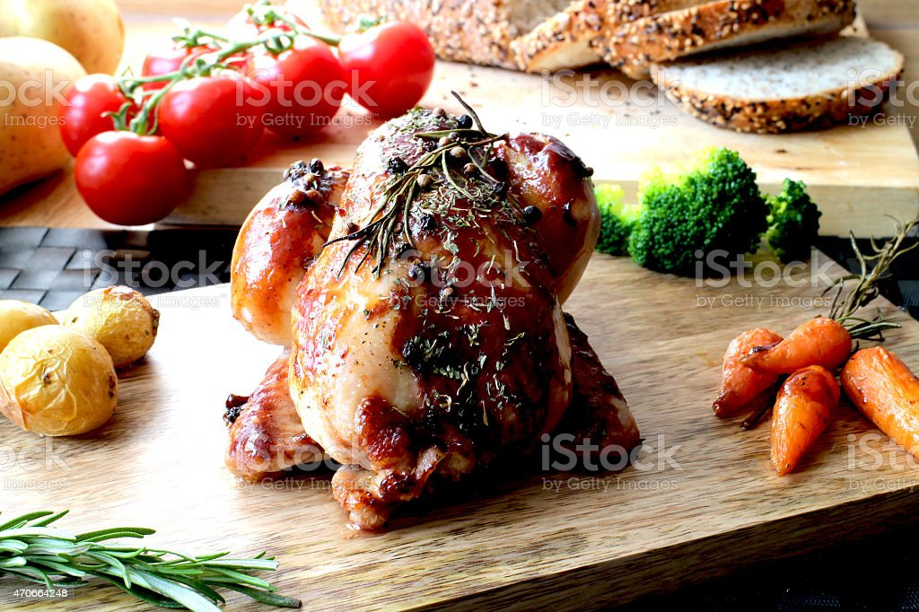 Whole Roasted Poussin little chicken stock photo