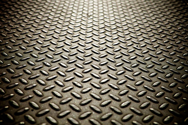 whole screen view of metal diamond plate flooring. - diamond plate background stock photos and pictures