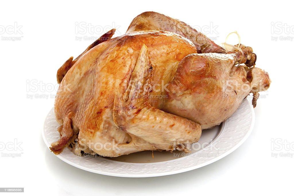 A whole seasoned roasted turkey on a white background royalty-free stock photo