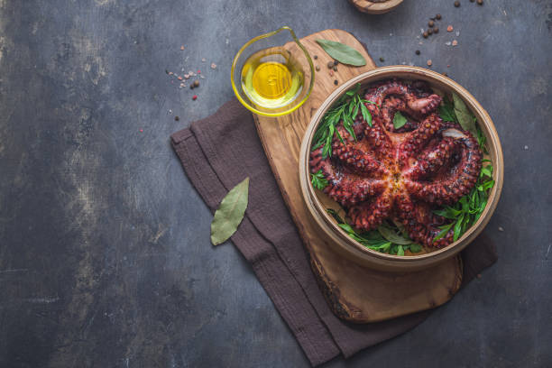 Whole steamed octopus with parsley and spices, copy space stock photo