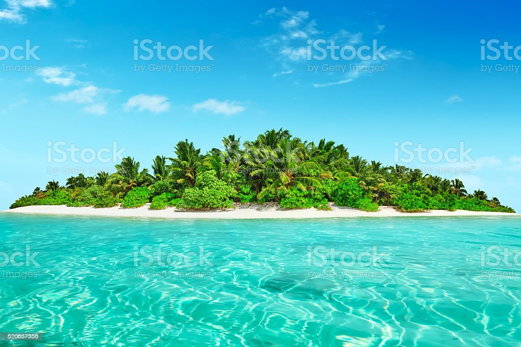 Whole tropical island within atoll in tropical Ocean. stock photo