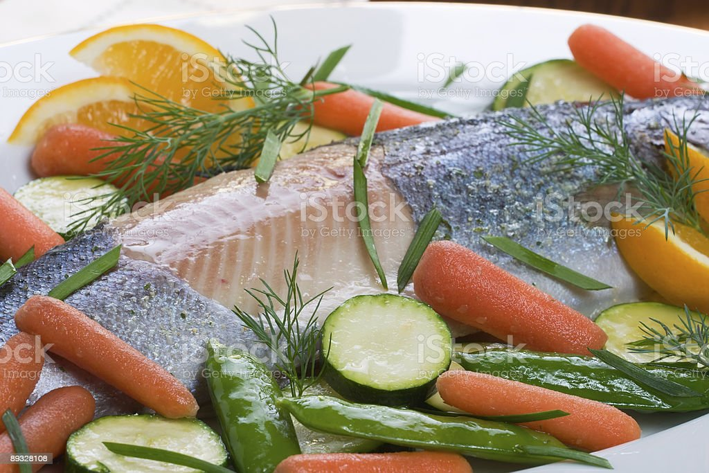 Whole trout baked with dill sauce royalty-free stock photo