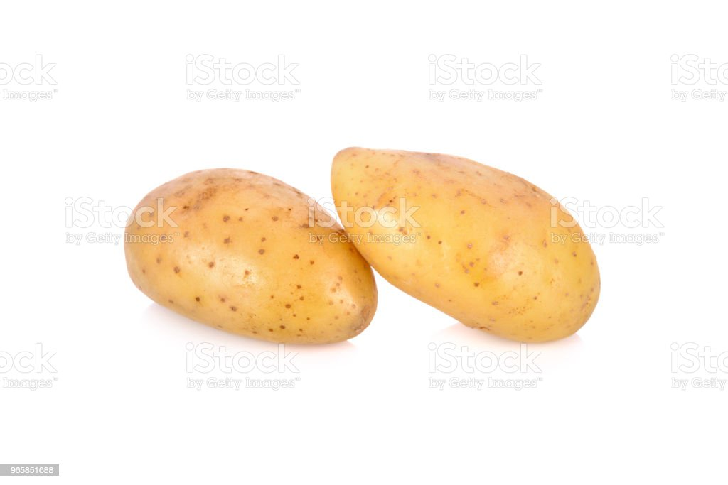 whole unpeeled fresh potatoes on white background - Royalty-free Agriculture Stock Photo